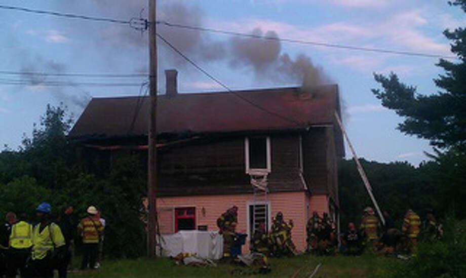 Fire in Waterbury at 60 Clover Street on Thursday, July 29, 2011. Photo: Contributed Photo/WTNH News 8, WTNH News 8