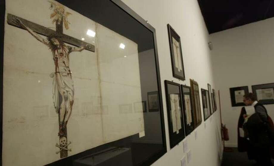 Among the displays is a watercolor drawing of the crucifix designed for San Damiano Church in Assisi. The Holy Office later eliminated the blood coming from Jesus' knees. Photo: ANDREW MEDICHINI, ASSOCIATED PRESS