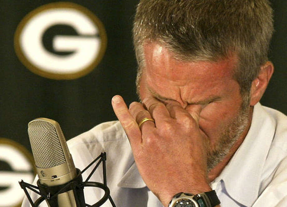 Packers quarterback Brett Favre said he promised himself he wasn't going to get emotional, but hestruggled just to get through the first minute of his opening statement Thursday at Lambeau Field. Photo: Cory Dellenbach, AP