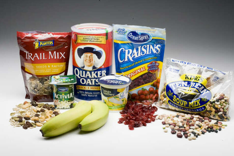 Prebiotic foods such as nuts, seeds, oats and legumes help set the stage for probiotics. Photo: Buster Dean, Chronicle