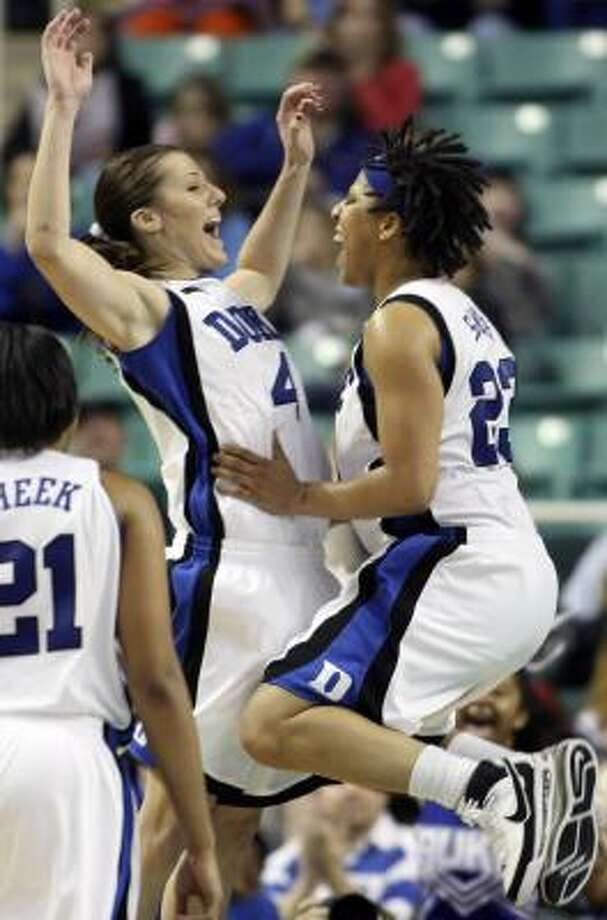 Duke's Abby Waner, left, and Wanisha Smith celebrate the Blue Devils' 74-63 upest of No. 5 Maryland. Photo: NELL REDMOND, AP