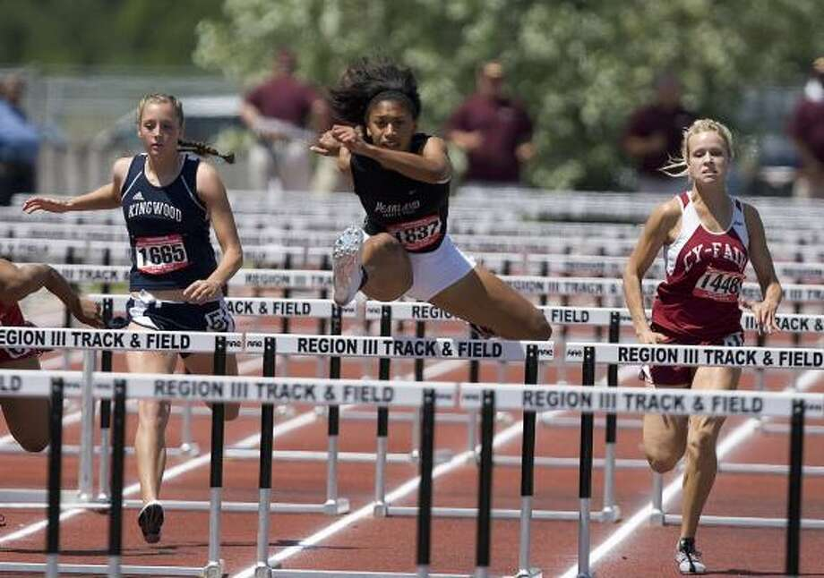 Pearland's Jessica Flax, center, races toward a first-place finish in the girls 300-meter hurdles Saturday in Humble. Photo: BOB LEVEY, FOR THE CHRONICLE
