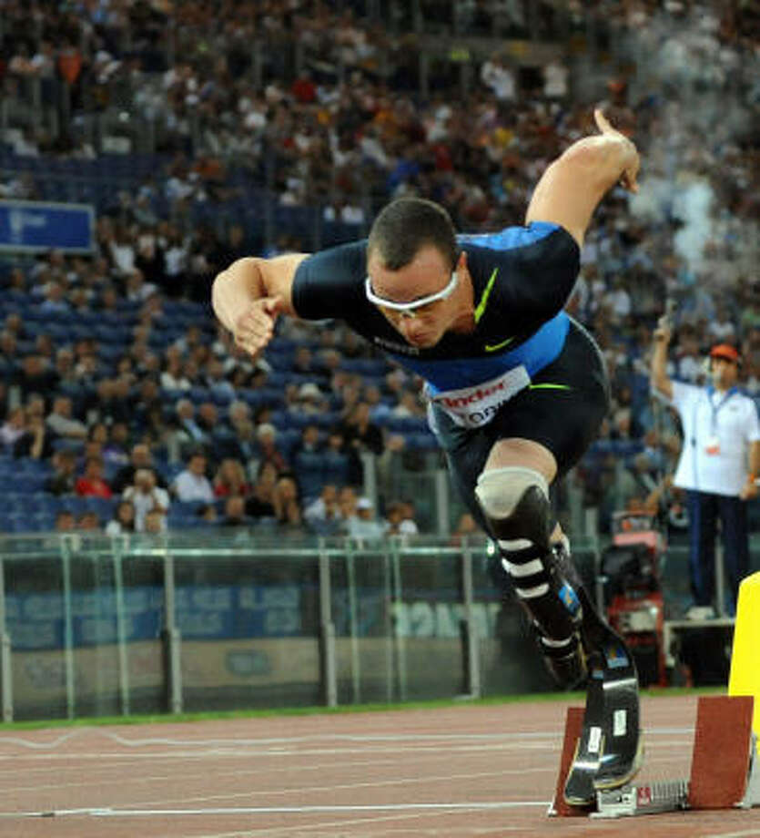 Oscar Pistorius (shown at a July 11 meet) said he will aim for running in 2012 in London. Photo: TIZIANA FABI, AFP/Getty Images