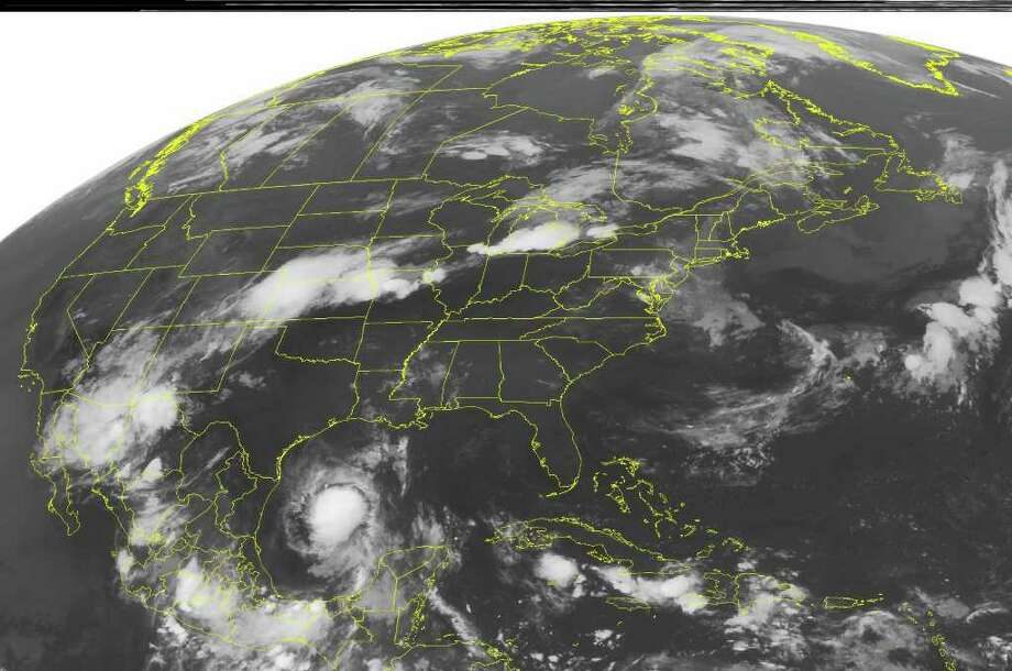 This NOAA satellite image taken Friday, July 29, 2011 at 1:45 a.m. EDT shows Tropical Storm Don continues moving through the western Gulf of Mexico, edging towards southeastern Texas. Maximum winds are at 45 mph, and intensification to Hurricane is not likely before making landfall.  In the north, a trough of low pressure moves off the Rockies and into the Plains, kicking up scattered showers and thunderstorms over the Central Plains.  A frontal boundary lingers over the Ohio River Valley, bringing scattered showers to the Northeast and Great Lakes.  High pressure over the Southeast allows for another sunny, hot, and muggy day. Photo: AP