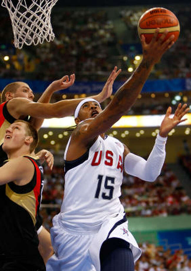 Carmelo Anthony drives to the basket over the defense of Germany. Photo: Jamie Squire, Getty Images