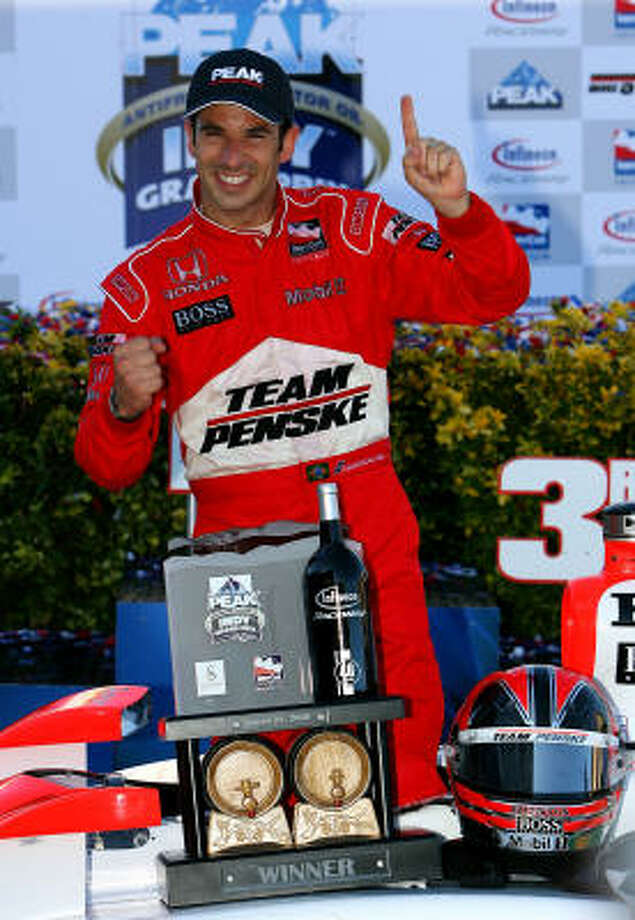 Helio Castroneves driver of the #3 Team Penske Dallara Honda celebrates winning the IRL IndyCar Series PEAK Antifreeze & Motor Oil Indy Grand Prix of Sonoma County. Photo: Darrell Ingham, Getty Images