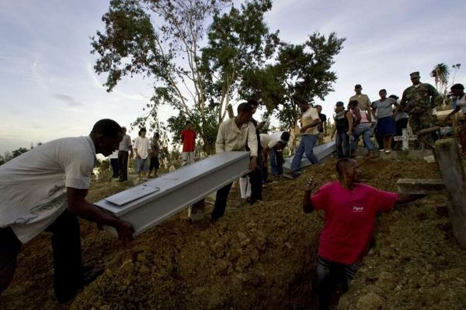 Two men carry the coffin of one those killed in a landslide caused by Gustav in Santo Domingo on Wednesday. Photo: Ramon Espinosa, Associated Press