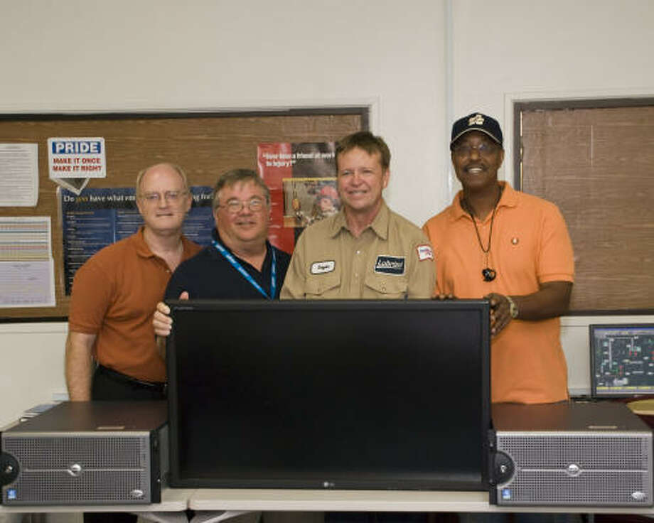 In an effort to enhance San Jacinto College's process technology program, The Lubrizol Corp. donated a plasma television and two servers. Pictured are Steven Horton, left, Keith Simpson, Bryan McMurtrie and Kenneth Jackson. Photo: Kyle Smith, For The Chronicle