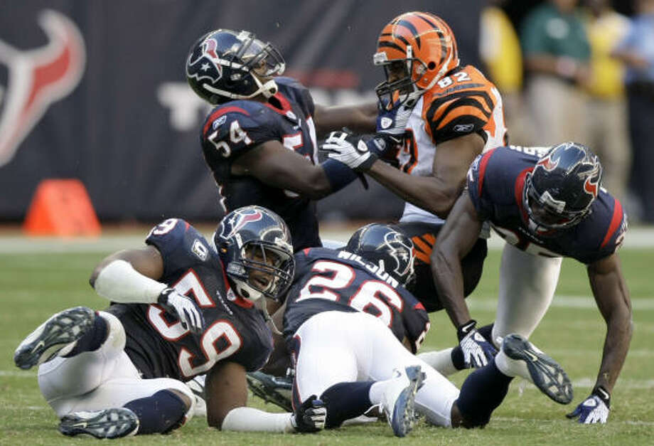 Texans defenders including Zac Diles (54), Nick Ferguson (25), DeMeco Ryans (59) and Eugene Wilson (26) swarmed to the ball and Bengals players like Reggie Kelly (82) all day. Photo: Brett Coomer, Chronicle