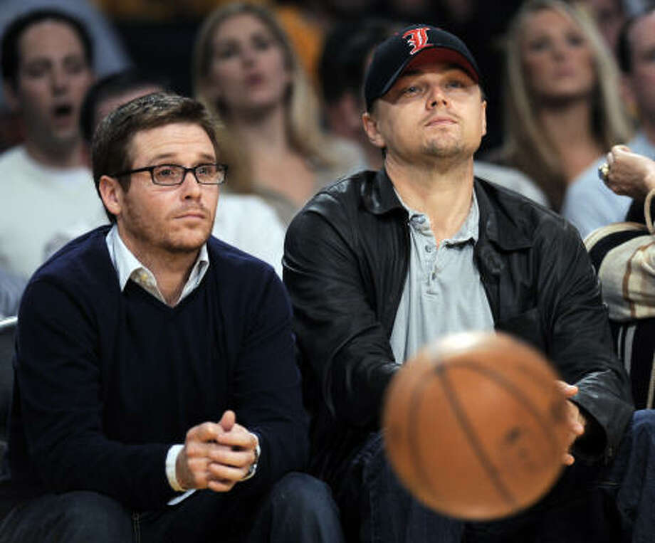 Leonardo DiCaprio, with Entourage's Kevin Connolly at Tuesday's Lakers game, has gathered a number of celebs to star in in a new public service announcement about the importance of voting. Photo: Kevork Djansezian, Associated Press