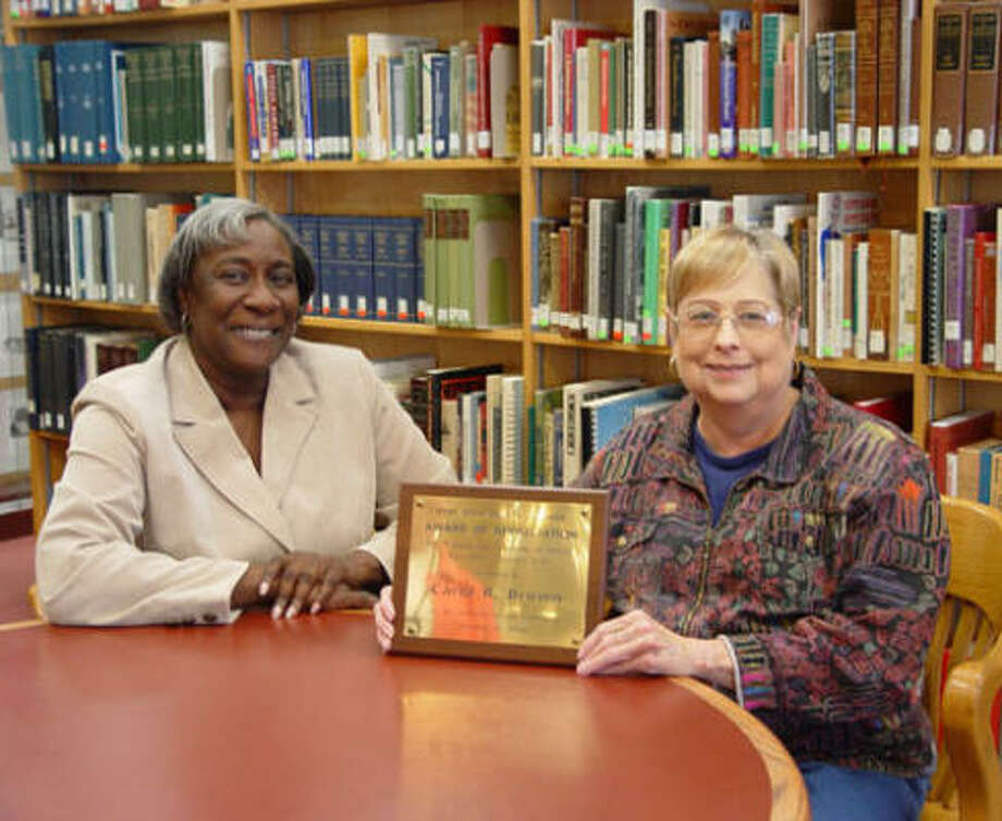 Clara Russell, left, is  the interim director of Fort Bend County Libraries, replacing library director Carol Brown, right, who retired after nearly 10 years with the library system. Photo: Courtesy Joyce Kennerly, Fort Bend County Libraries