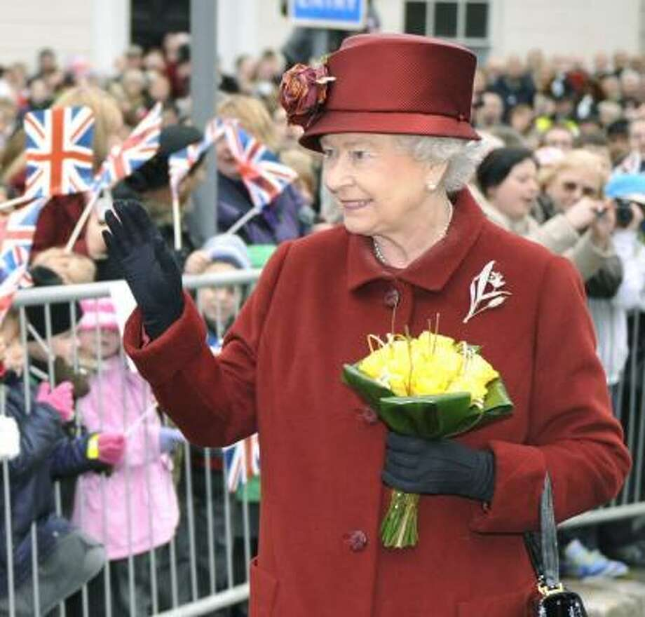 Queen Elizabeth II greets the public in Banbury, England, on Thursday wearing the same coat she wore to grandson Prince William's graduation from Sandhurst Military Academy in 2006. Photo: BEN BIRCHALL, ASSOCIATED PRESS