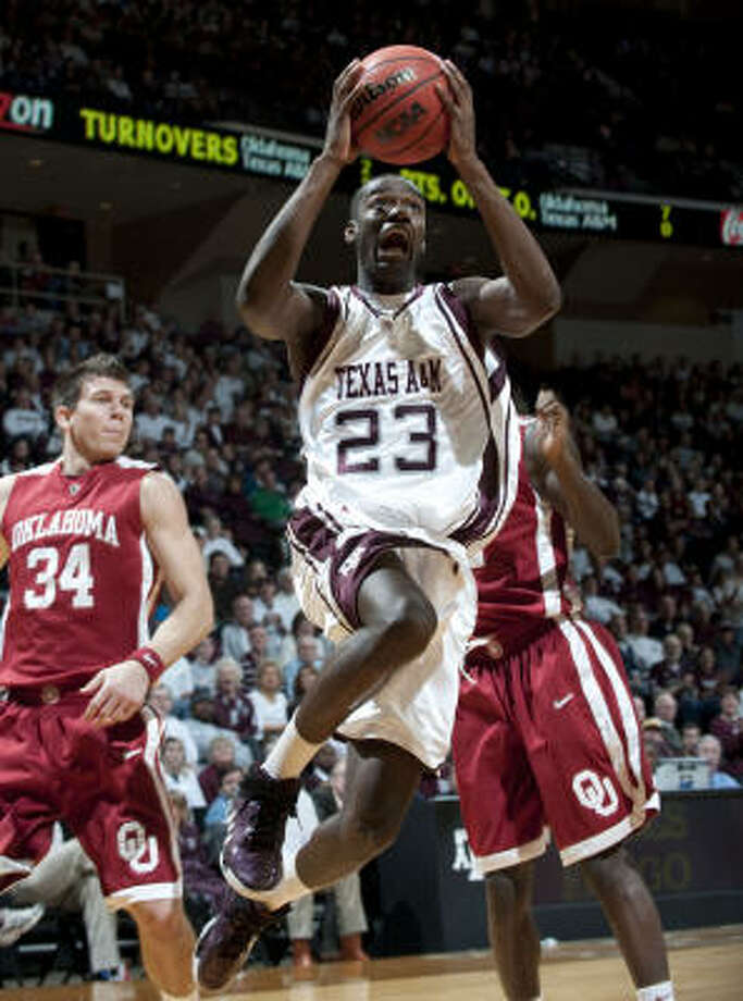 Texas A&M's Josh Carter (23), shown against Oklahoma on Jan. 17, has set the bar high for every Aggie in terms of production on the floor and in the classroom, says Richard Justice. Photo: Wade Barker, AP