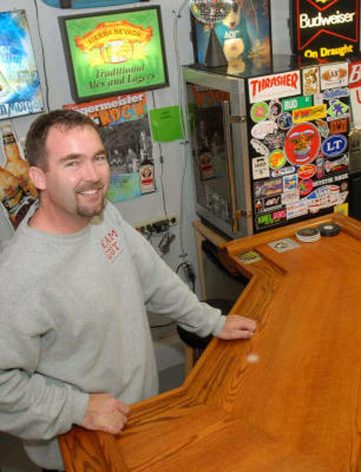 Dave Baker, of Dublin, Calif., mans the bar in his man cave. Photo: DOUG DORAN PHOTOS:, MCT