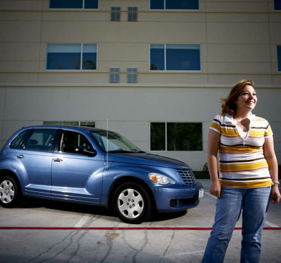 Misty Postell and her husband bought a 2007 Chrysler PT Cruiser with the help of a $3,000 state incentive designed to get people out of older cars and into more fuel-efficient vehicles. Photo: Michael Paulsen, Chronicle