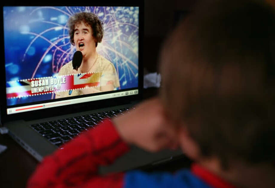 A young boy watches Britain's Got Talent contestant Susan Boyle on YouTube. Boyle has become a worldwide sensation after her singing stunned judges on the TV show. Photo: Jeff J Mitchell, Getty Images