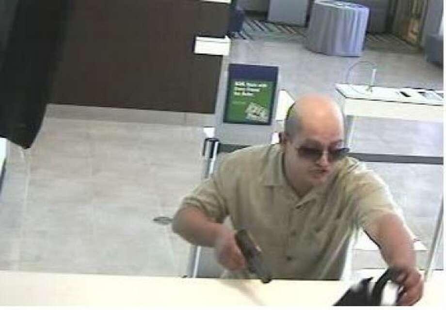 The man who robbed a Wachovia Bank on Memorial Drive this week threatened employees with a semi-automatic pistol and ordered them to fill a black bag with cash. Photo: FBI Houston