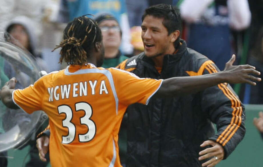 The departure of Joseph Ngwenya, left, leaves Brian Ching as one of the Dynamo's only big guns at forward. Photo: James Nielsen, Chronicle