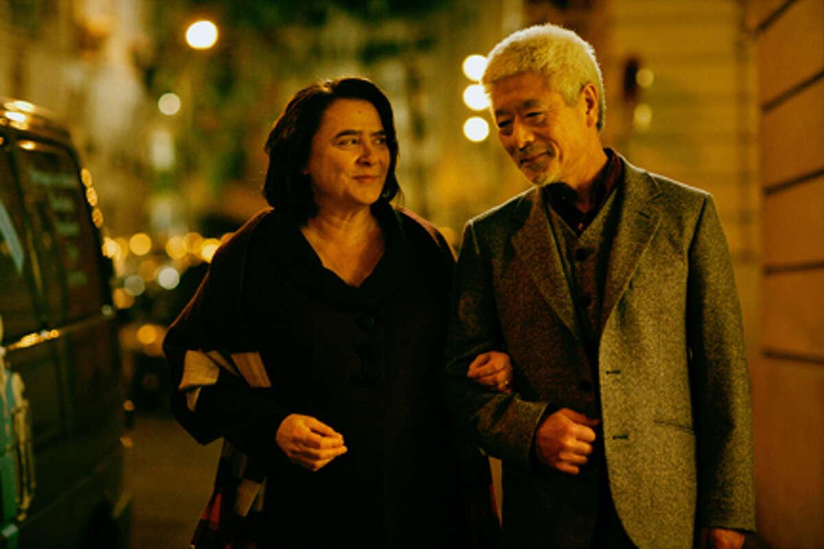 "Josiane Balasko as Renée Michel and Togo Igawa as Kakuro Ozu in ""The Hedgehog."""