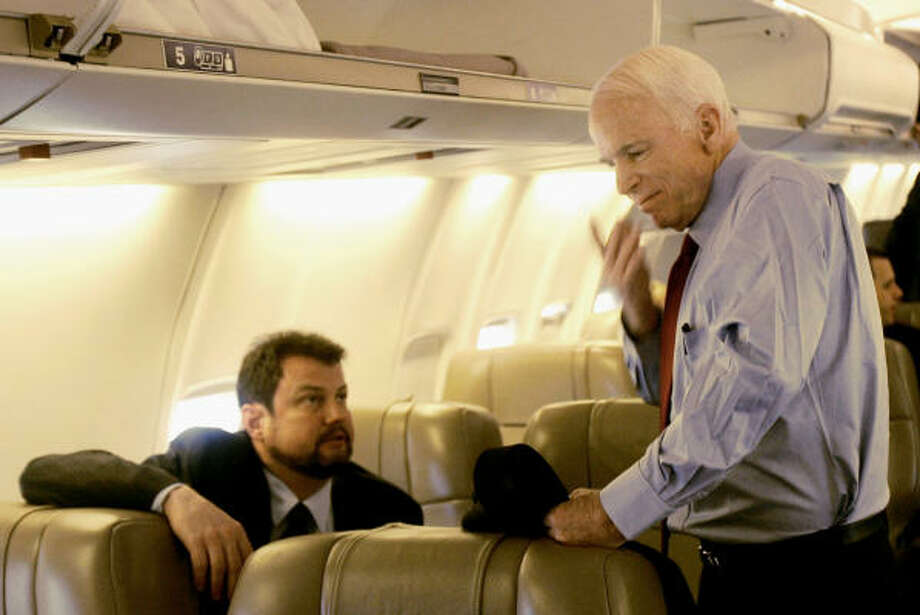 Republican presidential candidate Sen. John McCain, R-Ariz. right, speaks with his director of foreign policy and national security Randy Scheunemann as they board McCain's chartered plane in May. Photo: Jeff Chiu, AP