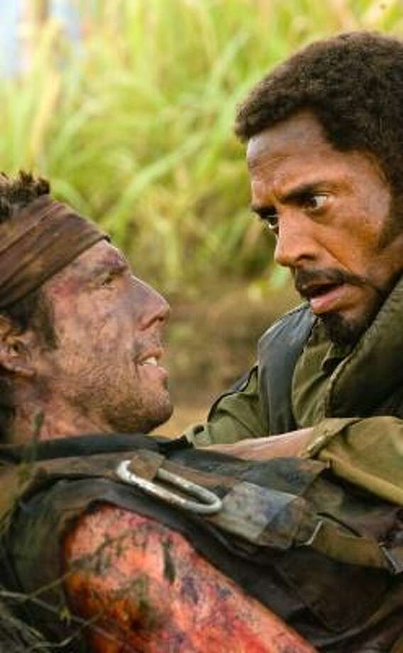 Ben Stiller, left, and Robert Downey Jr. star in Tropic Thunder. The film about actors who are caught up in real battle while shooting a war movie remained No. 1 for a second straight week at the weekend box office. Photo: MERIE WEISMILLER WALLACE, PARAMOUNT PICTURES