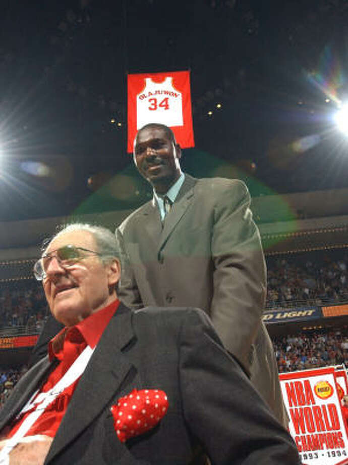 Former UH coach Guy V. Lewis, left, and Hakeem Olajuwon helped transform the Cougars into a college basketball powerhouse. Photo: KAREN WARREN, HOUSTON CHRONICLE