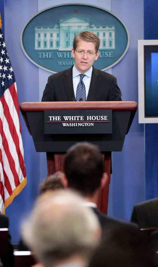 White House Press Secretary Jay Carney speaks during his daily news briefing at the White House in Washington, Friday, July, 8, 2011. Photo: AP