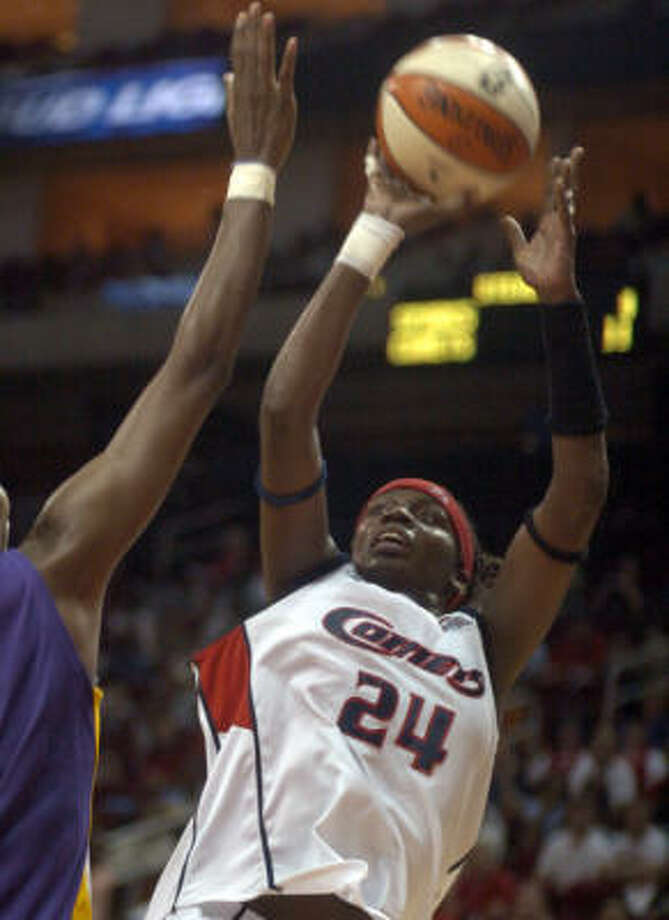 Houston Comets' Tari Phillips puts up a shot for a miss against the Los Angeles Sparks' Lisa Leslie during the second half in the Comets, 56-52 loss to the Sparks on Tuesday. Photo: Johnny Hanson, For The Chronicle