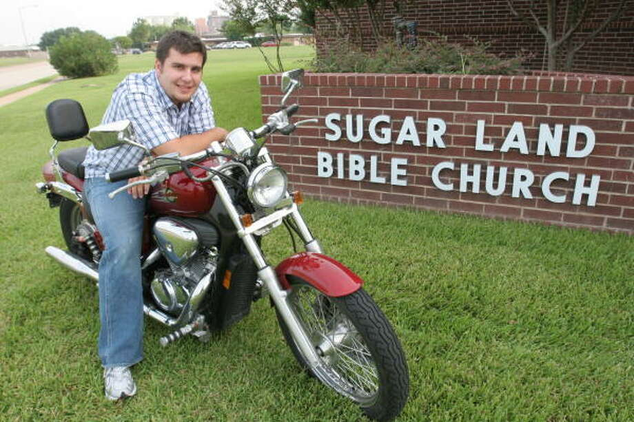 Michael Taylor, 22, of Sugar Land is the new youth minister of Sugar Land Bible Church, 401 Matlage Way in Sugar Land.  Taylor enjoys riding his Honda Shadow motorcycle to church. Photo: Suzanne Rehak, For The Chronicle