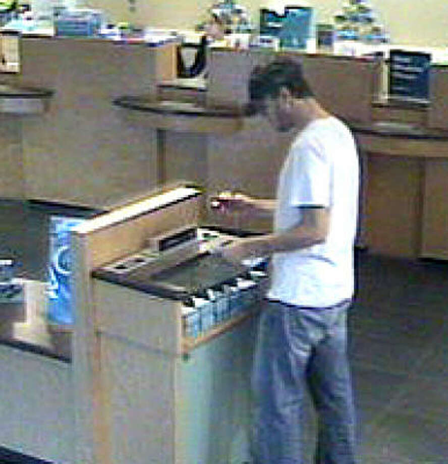 Suspect appears in surveillance video at Capital One bank branch that was robbed. Photo: FBI