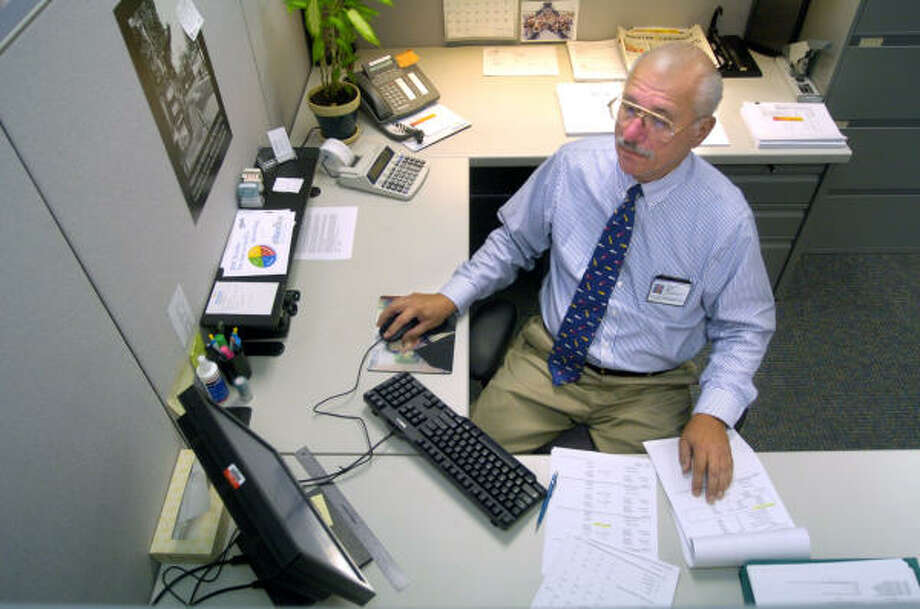 George Porter, 62, works 30 hours a week as a bookkeeper at the University of Texas M.D. Anderson Cancer Center after finding retirement boring after his career as an accountant for Williams Gas Pipeline. The U.S. faces a shortfall in skilled workers that promises to accelerate as more employees move toward retirement. Photo: Johnny Hanson, For The Chronicle