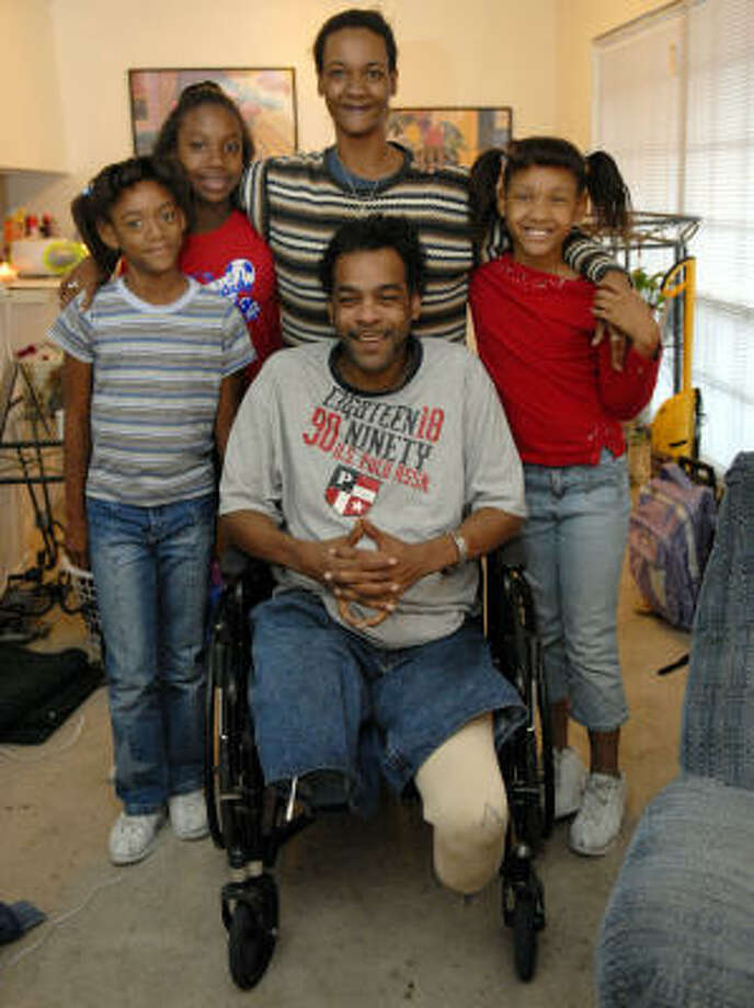 Christmas for Torren Mabra, wife Marisa, and children Emani, 8, left, Ernesta, 9, and Essence, 7, will be more cheerful with help from Goodfellows. Not pictured are Andre and Jazzmine. Photo: KIM CHRISTENSEN, For The Chronicle