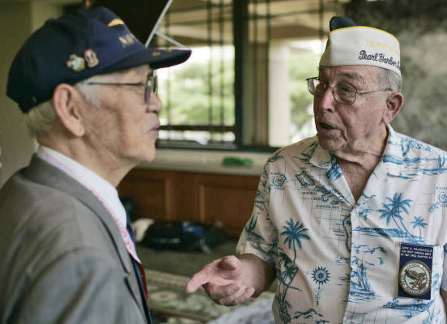 Pearl Harbor survivor John Rauschkolb, 85, right, meets former Japanese Navy aviator Takeshi Maeda, also 85, at Sunday's opening of Pearl Harbor's 65th anniversary symposium in Honolulu. Photo: MARCO GARCIA, AP