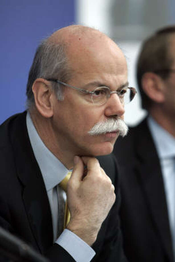 DaimlerChrysler AG chairman Dieter Zetsche is seen at the company's North American headquarters in Auburn Hills, Mich., Wednesday. DaimlerChrysler says it plans to axe 13,000 jobs at its loss-making Chrysler subsidiary as part of a broad restructuring plan. Photo: Carlos Osorio, AP