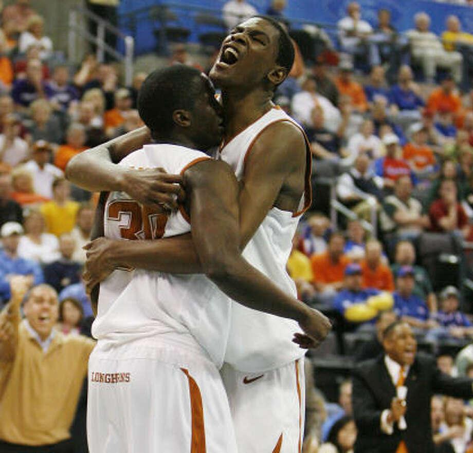Kevin Durant (right) played looser in the second half, sparking the comeback. Photo: James Nielsen, Chronicle
