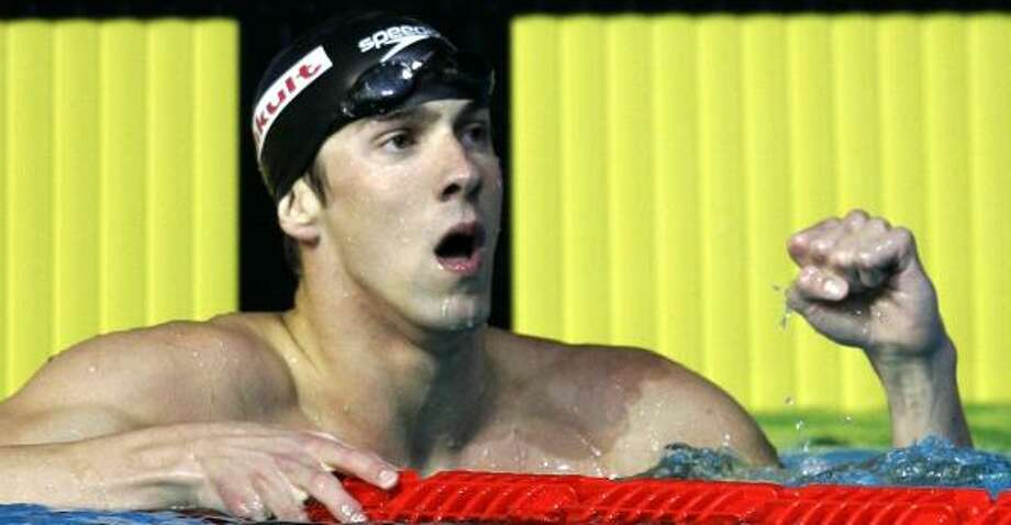 Micheal Phelps added to his gold-medal haul Saturday by beating Ian Crocker and the rest of the field in the 100-meter butterfly. Photo: MARK BAKER, ASSOCIATED PRESS