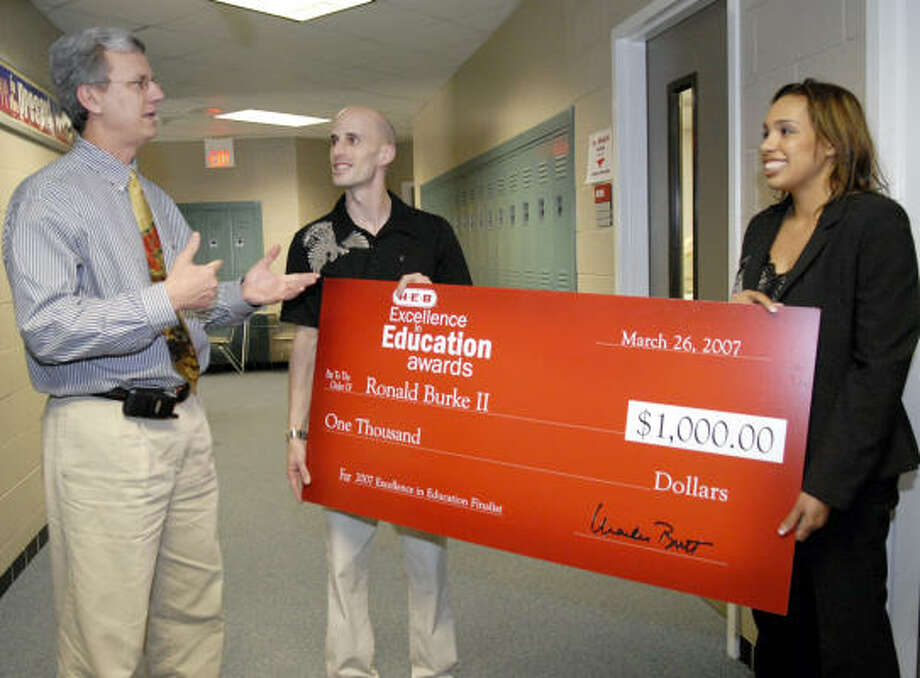North Shore Middle School Principal Paul Drexter talks with one of his teacher Ronald Burke II after he received a $1000.00 check from HEB representative Lacey Dalcour honoring his as one of the HEB teacher of the year recipients. Photo: Kim Christensen, For The Chronicle