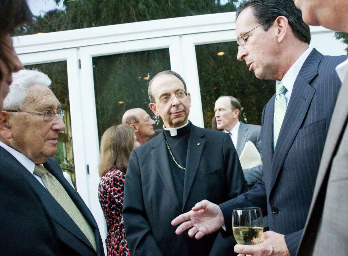 """Governor Dannel P. Malloy talks with Nobel Prize winner and former Secretary of State Henry Kissinger as Bishop Lori looks on at Robert Dilenschneider's home in Darien, Conn., July 28, 2011. Kissinger discussed his new book """"On China."""""""