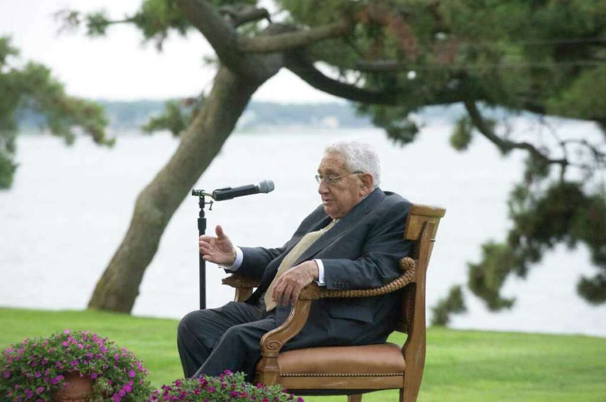 Nobel Prize winner and former Secretary of State Henry Kissinger addresses an audience at Robert Dilenschneider's home in Darien, Conn., July 28, 2011. Kissinger discussed his new book,
