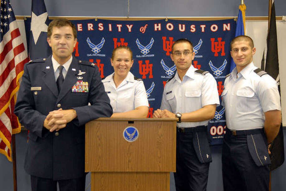 U.S. Air Force Col. Phil Bossert, left, with AFROTC cadets Jennifer Walne, Jared Schultz and Elias Yousefi, said ROTC cadets help keep the U.S. Armed Forces strong and vital. Photo: Kim Christensen, For The Chronicle