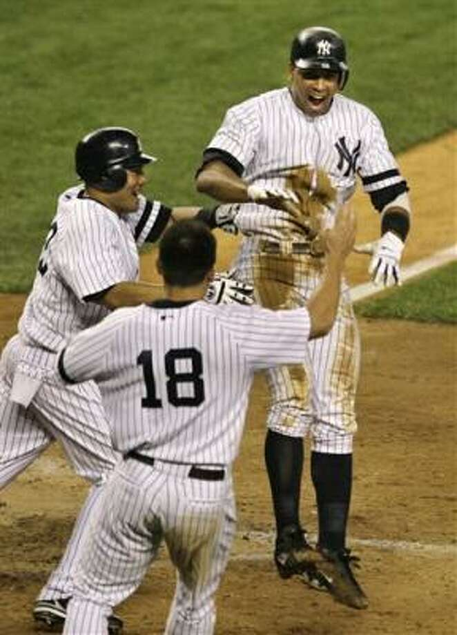 Alex Rodríguez scores the winning run in New York's 10th win in 13 games. Photo: Kathy Willens, AP