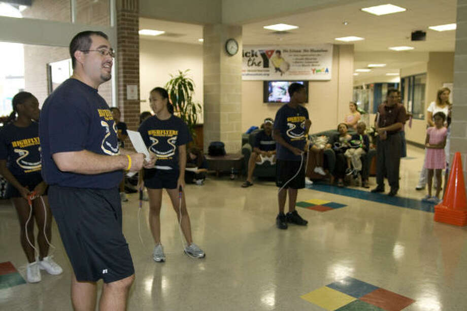 Coach David Cazares introduces the Highflyers jump rope team at the Katy YMCA to demonstrate the new program available to members. Photo: Kenzie DelaTorre, For The Chronicle