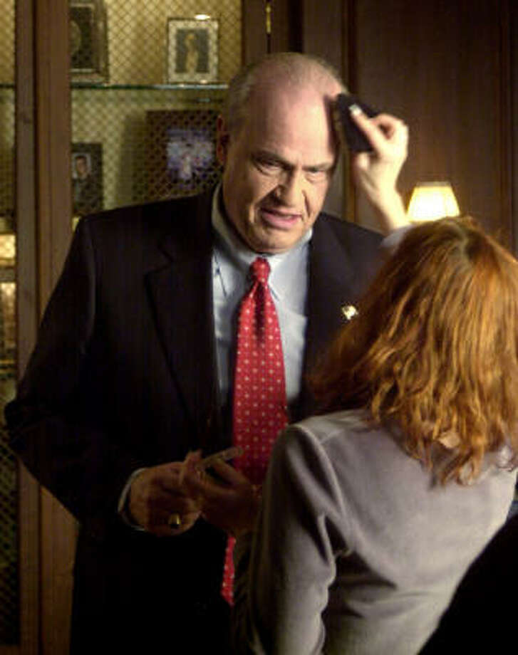 "Former Sen. Fred Thompson, R-Tenn., has makeup applied on the set of the television show ""Law & Order"" in New York in 2003. Photo: MATT MOYER, AP"