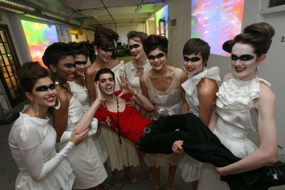 """Thommy Douglass enjoyed unusual transport by models wearing his """"Andrea"""" line at  the Opticks Spacetaker Gala at Winter Street Studios. Photo: Bill Olive, For The Chronicle"""