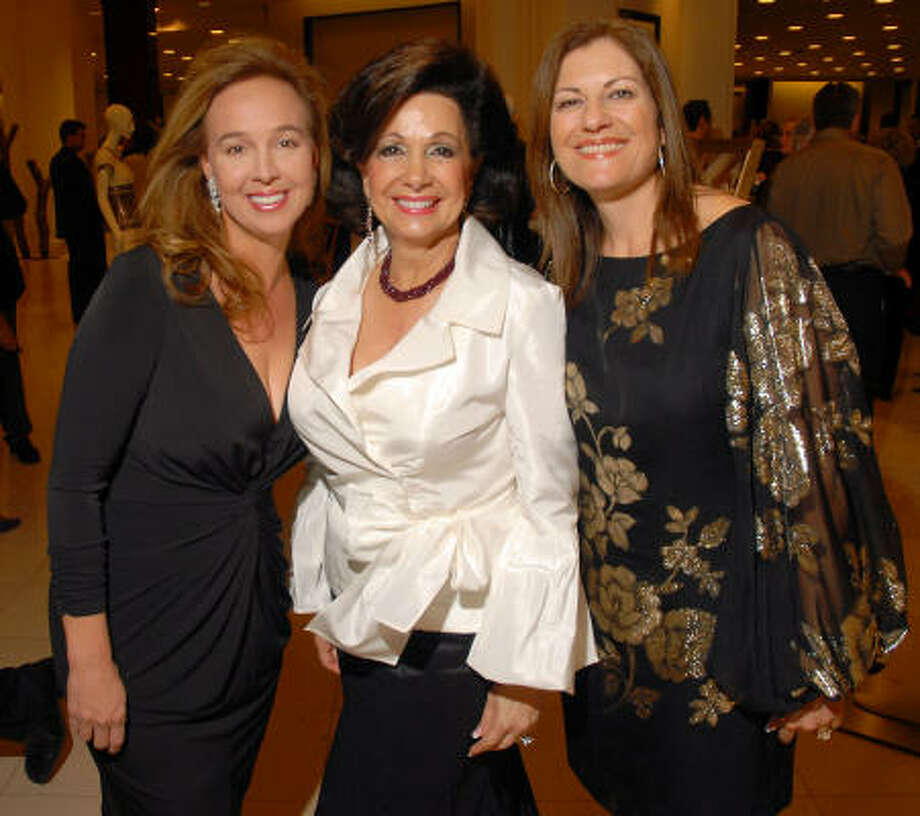 The 2008 Winter Ball chairs Julie Brown, from left, Philamena Baird and Ellie Francisco greeted the 300 guests attending the Women of Distinction announcement party at Saks Fifth Avenue. Photo: Dave Rossman, For The Chronicle