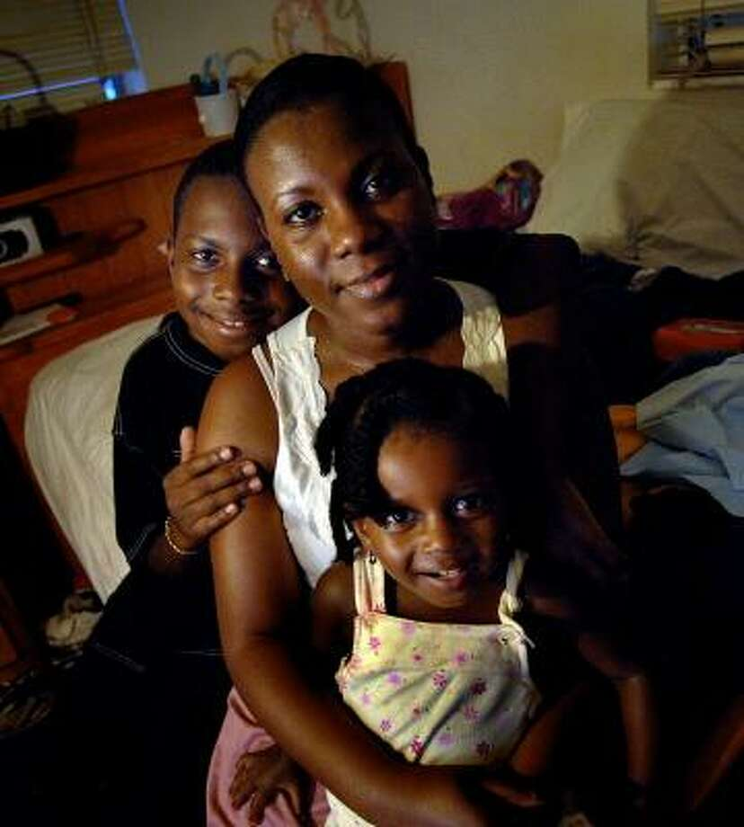 Marjorie Norval, along with son Tyree and daughter Tianna, moved in with her mom after her condominium in Lauderhill, Fla., was heavily damaged by Hurricane Wilma. Photo: ROBERT DUYOS, SOUTH FLORIDA SUN-SENTINEL