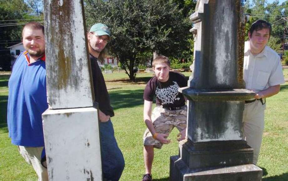 From left, Chad Upchurch, Carey Libby, Ryan Lackey and Allen Harris are part of the eight-member Paranormal Investigation Tracking Team. The team, which does not accept money for its investigations, decides as a group which cases to take. Photo: CHRISTY WOOTEN, COX EAST TEXAS