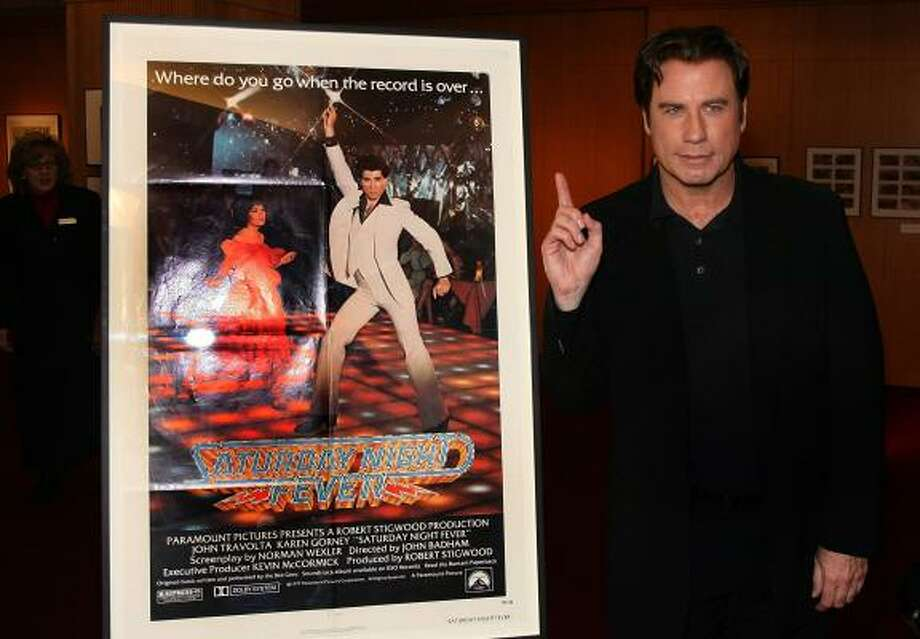 "Actor John Travolta at the 30th anniversary celebration of ""Saturday Night Fever,"" in which he starred as a working-class man who danced his way out of a dead-end life. Photo: Frazer Harrison, GETTY IMAGES"