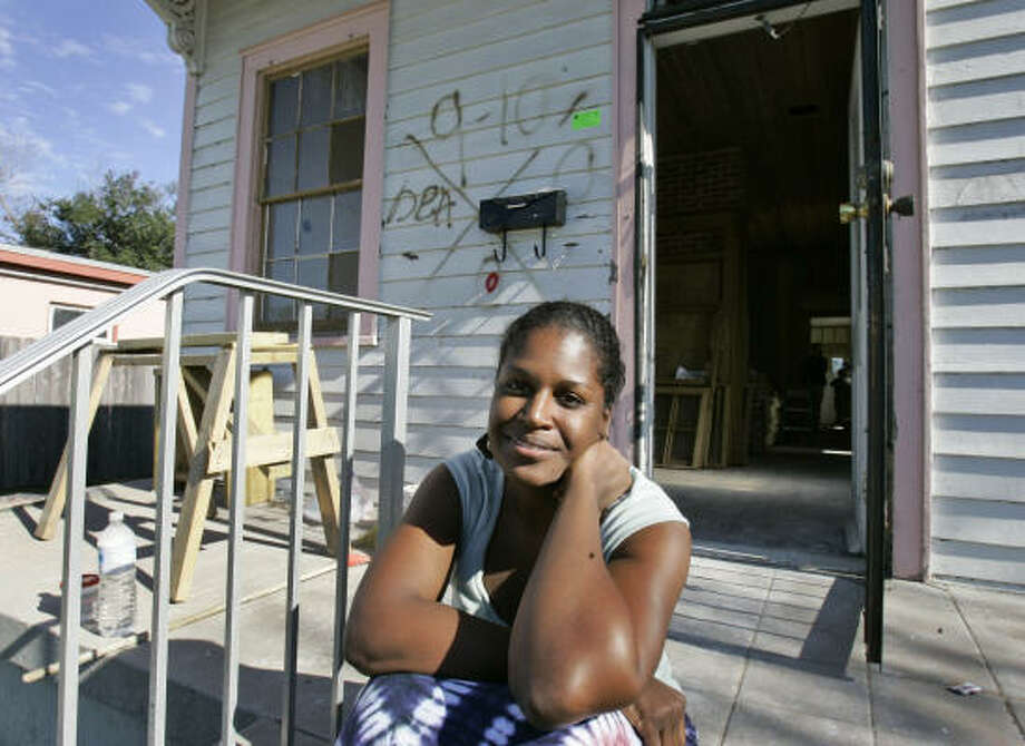 """Rashida Ferdinand sits in front of her house in the Lower Ninth Ward of New Orleans on Monday.  The television program, """"This Old House"""" will cover in great detail the rebuilding of her 1892 Creole shotgun-style home. The show's 10-episode series featuring New Orleans area homes is scheduled to begin airing nationally next month on PBS. Photo: Alex Brandon, AP"""