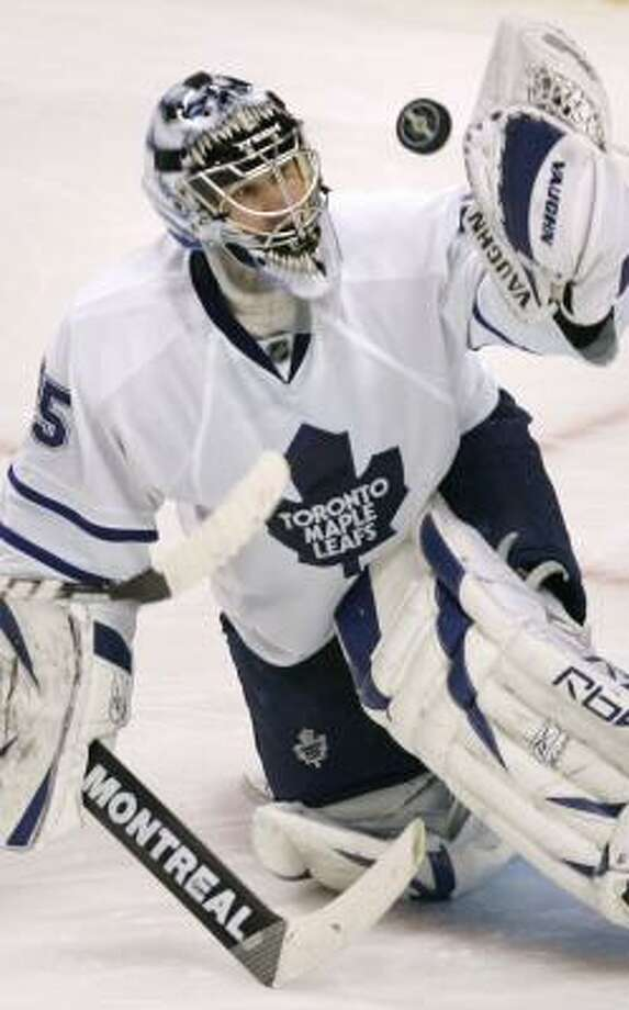 Maple Leafs goalie Vesa Toskala makes a glove save during a shootout on Thursday. Photo: CHARLES KRUPA, AP